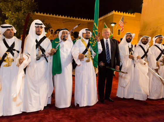 President Trump stands surrounded by ceremonial swordsmen during his visit to Saudi Arabia in 2017.